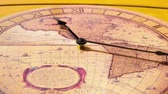 timekeeping : Analog Clock with the image of the world map hanging on the wall and work. Minute and hour hands run along the rim of the dial. Timelapse.