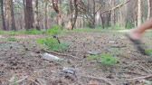 utilization : Man beats foot plastic bottle in the forest. Stock Footage
