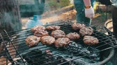 chargrilled : Meat for Burgers Prepared On The Grill Stock Footage