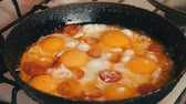 popping : Fried Eggs with Vegetables Prepared on a Frying Pan Stock Footage