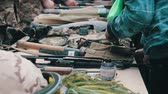 kalashnikov : Weapons, Automatic Machines, Grenades, Ammunition, Bullets are on the Table, and Military Stock Footage