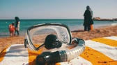 fitness : Diving Mask with a Tube for Snorkeling Lying on a Lounger on the Background of the Red Sea Beach in Egypt
