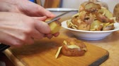 nutritious : Cleaning Potatoes in the Home Kitchen Stock Footage