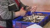 gutting : Woman Vendor Cut Up the Fish in the Fish Market Stock Footage