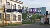 clothe : Clothes Weigh and Dry on a Rope in a Multi-Storey Building in a Poor Neighborhood of the City