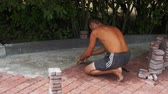 bricklayer : Worker is Laying Paving Stones using Hammer Stock Footage