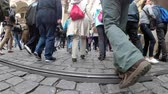 thwart : Legs of the Crowd of people cross the road on a pedestrian crossing