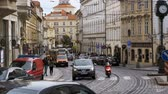 main line : Car Traffic and Czech Tram Rides through the Old City of the Czech Republic, Prague. Slow Motion