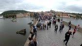 charles bridge : Crowd of tourists walking along the Charles Bridge, Prague, Czech Republic Stock Footage