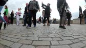 charles bridge : Legs of Crowd tourists walking along the Charles Bridge, Prague, Czech Republic Stock Footage