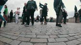 charles bridge : Legs of Crowd People walking along the Charles Bridge, Prague, Czech Republic
