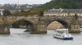Влтава : Landscape view of Prague Bridge and Water Bus Boat Floating on the River Vltava