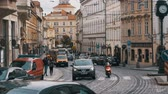 construction roads : Car Traffic and Czech Tram Rides through the Old City of the Czech Republic, Prague. Slow Motion