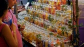 ananász : Showcase with Fruits in plastic cups at Night Market on Jomtien Beach. Pattaya, Thailand