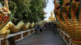 шуй : People on Pratumnak Hill near Big Golden Buddha statue. Temple of big golden Buddha. Thailand
