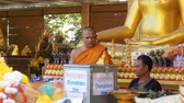 alms : Monk near the donations box in the Buddhist Thailand Temple. Pattaya