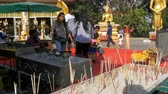 wat : Thai people pray in the temple of the golden Buddha. Thailand. Pattaya Stock Footage
