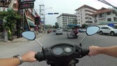 lambreta : POV view on Riding motorbike along the Asian Road Traffic. Thailand, Pattaya
