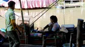 exciting : Pattaya Floating Market. A woman seller in a small boat is preparing food. Thailand