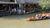 pattaya : Pattaya Floating Market. Small Tourist Wooden Boat moving along the Water. Thailand Stock Footage
