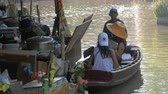 canoe : Pattaya Floating Market. Small Tourist Wooden Boat moving along the Water. Thailand Stock Footage
