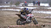 motorized sport : Motocross. Racer starts his motorcycle on the track. Off-road racing on enduro bikes. Slow motion