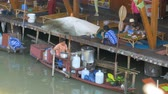 both : Pattaya Floating Market. Sellers with goods on boats in the water. Thailand, Asia