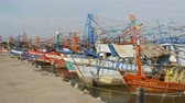 leilão : Many different old wooden fishing boats at the pier. Thailand. Asia. Pattaya Vídeos
