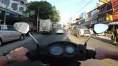 first : POV view on Riding motorbike along the Asian Road Traffic. Thailand, Pattaya