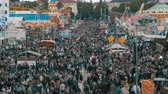fairgrounds : Top view on crowd of people on central street in Oktoberfest. Bavaria, Germany Stock Footage