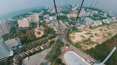 ugró : First person view of a man goes down on the cable from the roof on the Pattaya City Tower