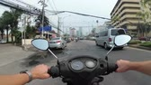 good time : POV view on Riding motorbike along the Asian Road Traffic. Thailand, Pattaya