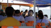 captain : People go by the sea on the ferry and sit on the seats. Inside view. Thailand.