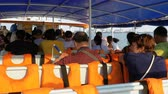 indočína : People go by the sea on the ferry and sit on the seats. Inside view. Thailand.