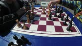 ponderando : Chessboard and figures. Competitions in checkers among children