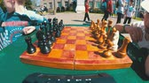 porazit : Chessboard and figures. Competitions in checkers among children
