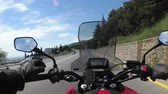 first person view : Motorcyclist Rides on the Scenic Mountain Road on Serpentine in the Mountains
