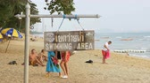 konak : Plate with the inscription Swimming area on the beach of Jomtien. Pattaya, Thailand Stok Video