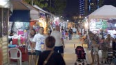 basting : People Walk at Asian Street Food Night Market on Jomtien Beach. Thailand, Pattaya Stock Footage