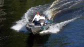 litwa : People on a fast motor boat are Sailing along the river in Slow Motion