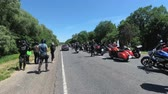 bando : A column of motorcyclists stands on the road. Bike festival