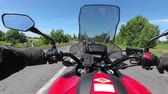 first person view : Chest view on the helm of motorcycle riding in a column of bikers on the road