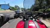 pov : Chest view on the helm of motorcycle riding in a column of bikers on the road