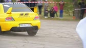 iszapos : Championship in Rally. Rally Racing on sports cars on the asphalt road in the city Stock mozgókép