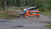 danube delta : Championship in Rally. Rally Racing on sports cars on the asphalt road in the city Stock Footage