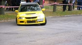 dallam : Championship in Rally. Rally Racing on sports cars on the asphalt road in the city Stock mozgókép
