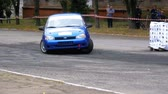 sarok : Championship in Rally. Rally Racing on sports cars on the asphalt road in the city Stock mozgókép