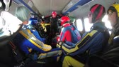 udatnost : Group of parachutists sits inside a small plane awaiting a jump. Slow Motion