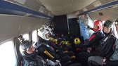 crazy : Group of skydivers sits inside a small plane awaiting a jump