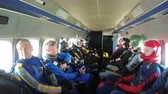 first person view : Group of parachutists sits inside a small plane awaiting a jump. Slow Motion